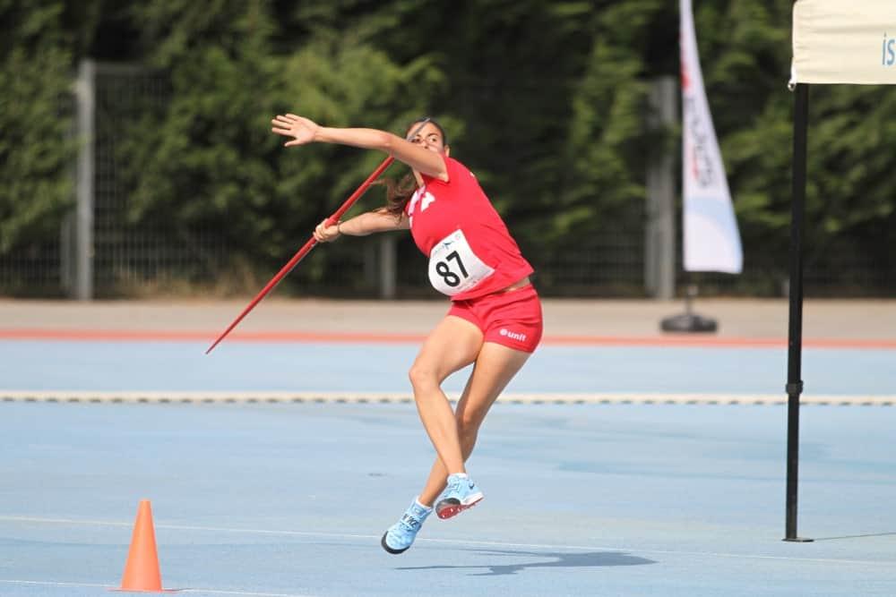 Athlete throwing javelin across the field