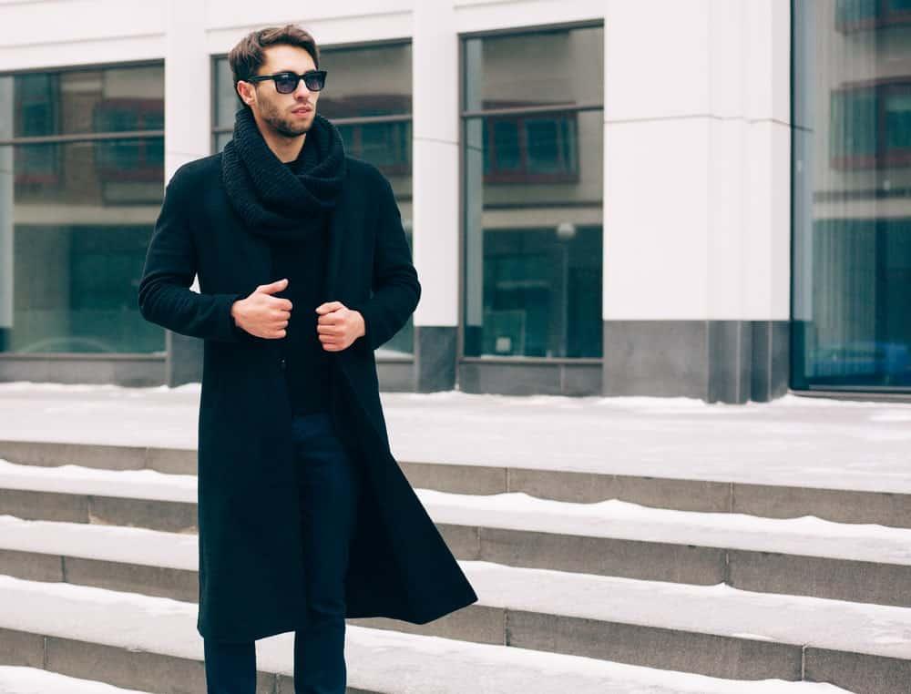 Man wearing a long coat