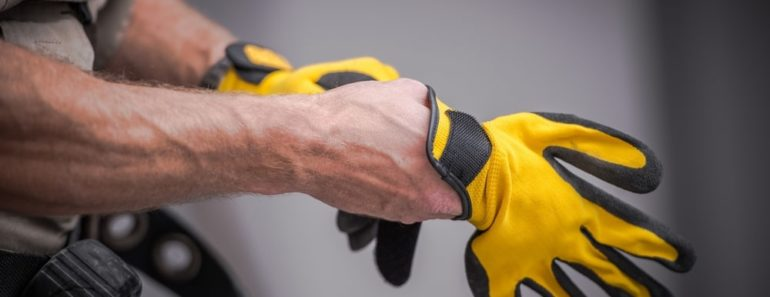 man trying on gloves