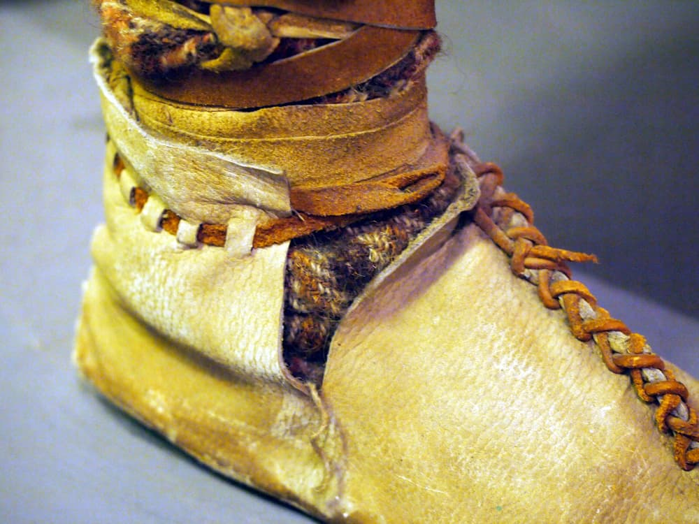Hay and deerskin human shoe