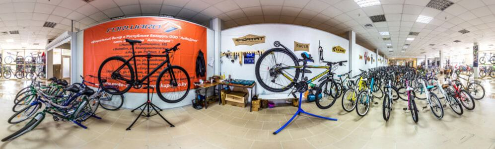 Panoramic view of a bicycle store interior.