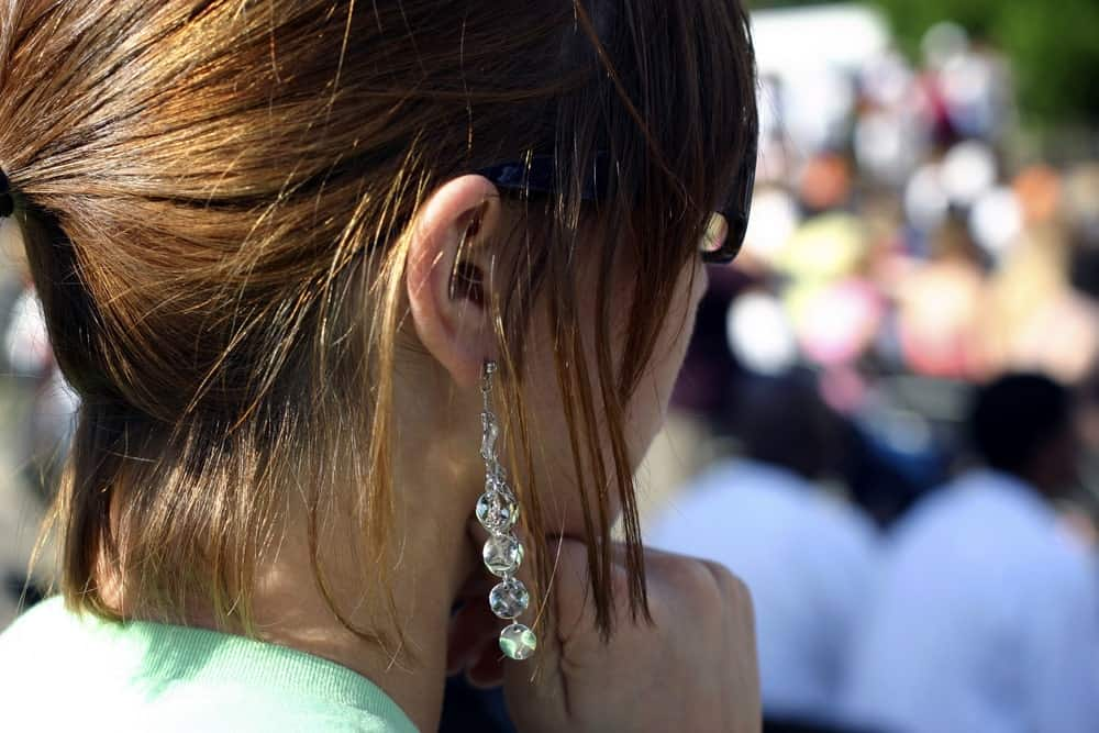 Side profile of a woman wearing dangles.