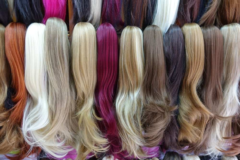 Rows of hairpieces in various colors.