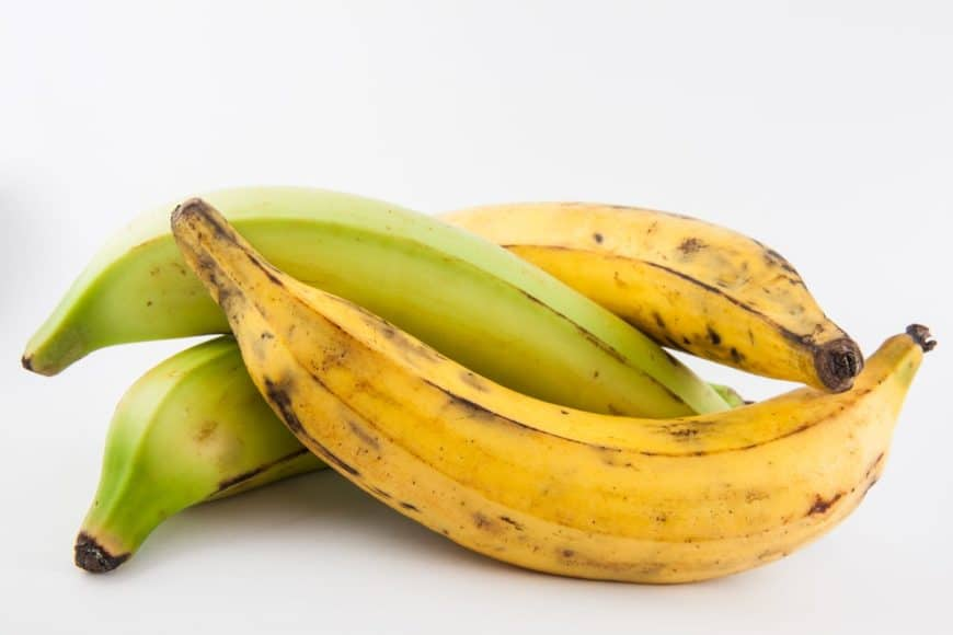 Two pairs of bananas and plantains.