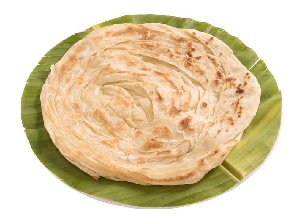 Paratha Bread on a Round Cut Banana Leaf.