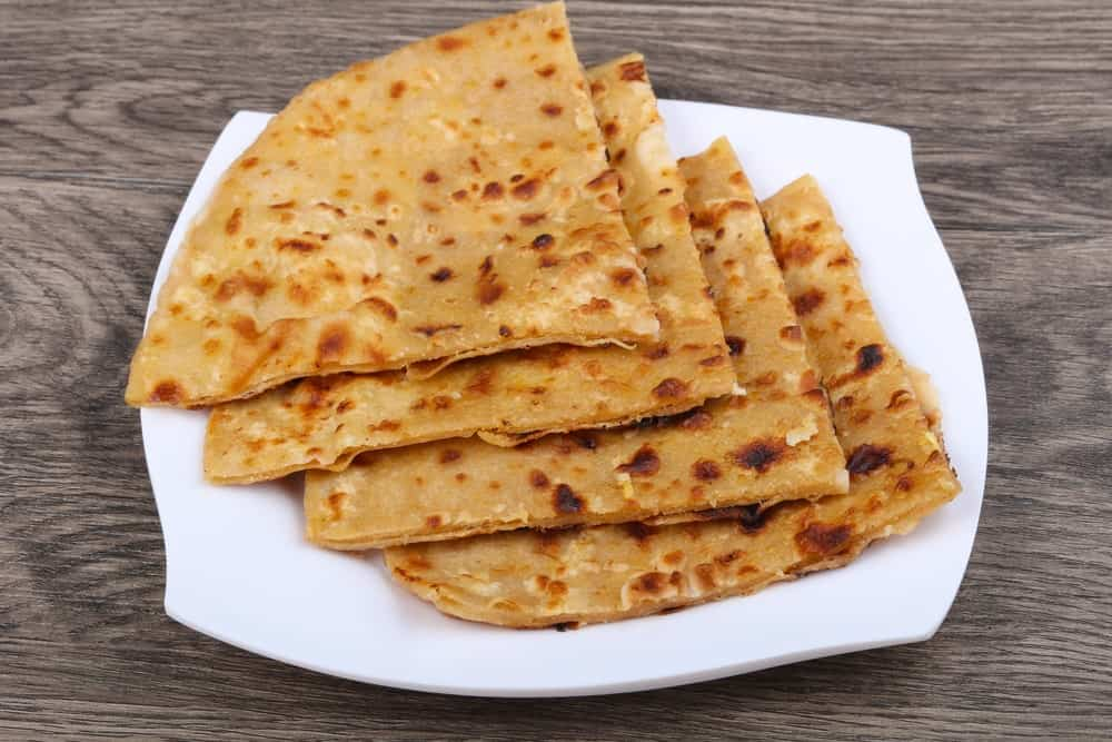 Pieces of Roti Bread on a Plate.