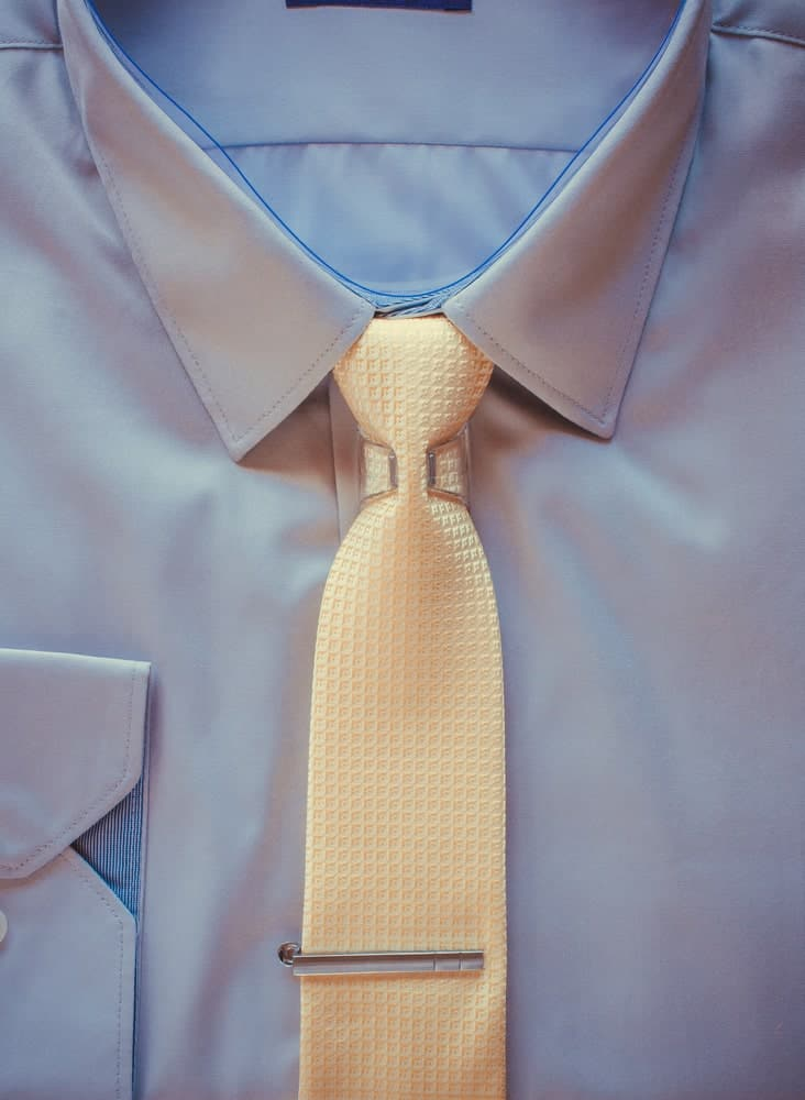 Clip on tie worn with a suit