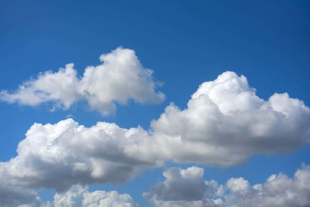White cumulus clouds over the blue sky