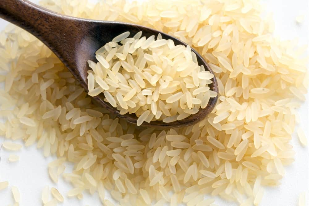 Parboiled Rice on a Small wooden Spoon