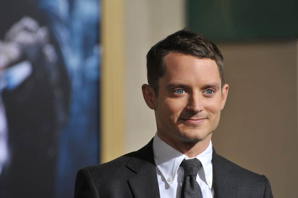 Elijah Wood Wearing a Black-Grey Suit