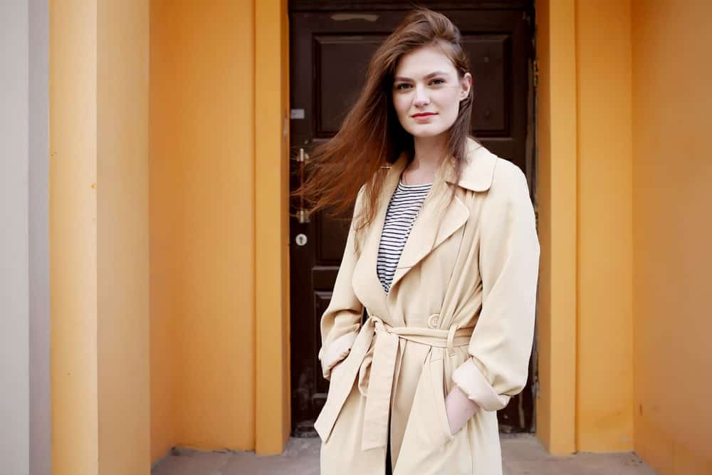 A Beige Trench Coat Sported by a Model