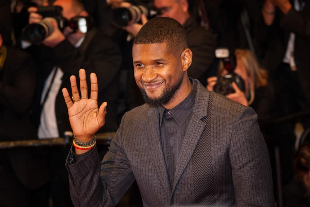 Usher waving at the camera
