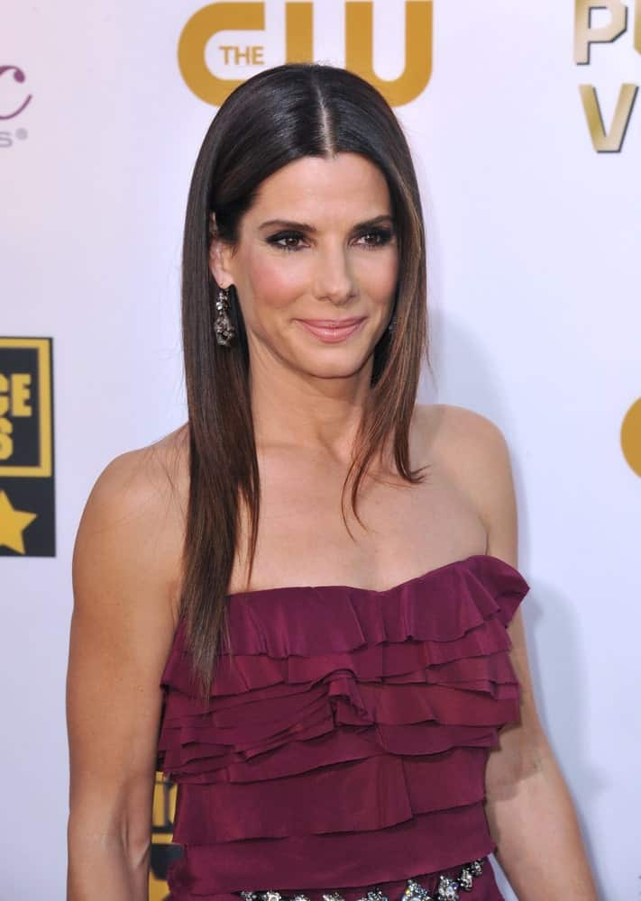 Sandra Bullock in a Maroon Ruffled Dress
