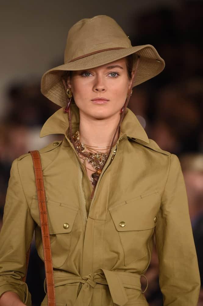 Woman wearing a drawstring jacket.