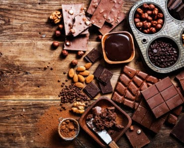 All different types of chocolate on a cutting board
