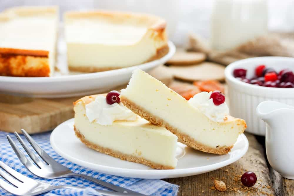 Two Slices of Classic Cheesecake on a Plate