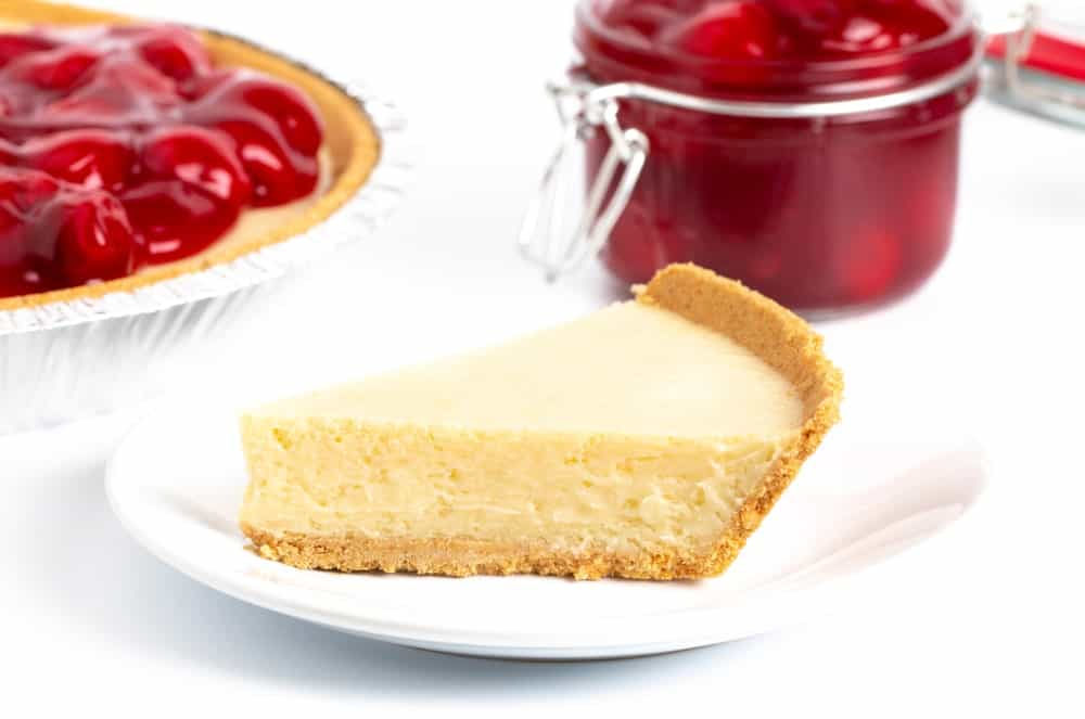 A slice of plain cheesecake