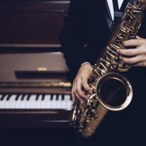 A Saxophonist with a Saxophone in His Hands