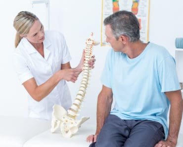 Chiropractor explaining the spine to patient