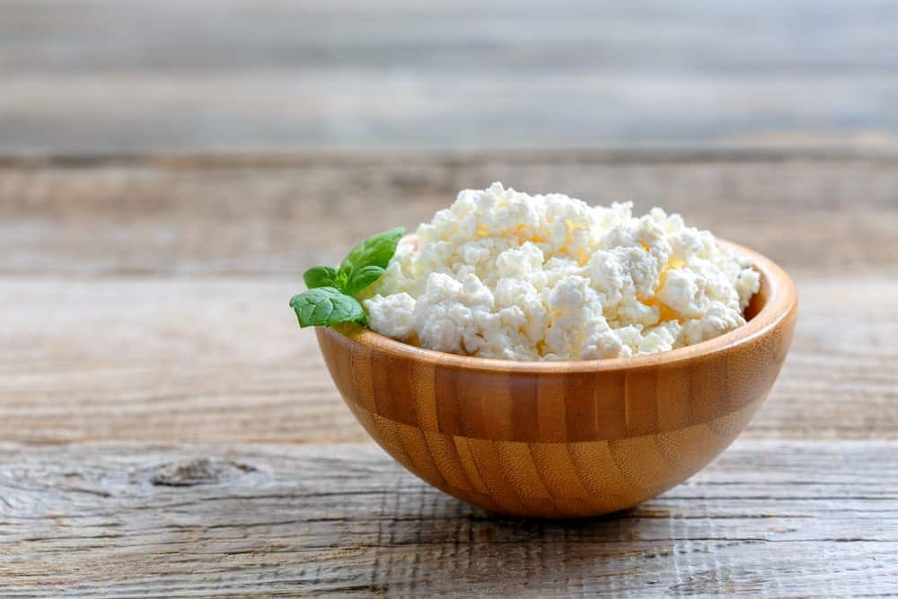Homemade Cottage Cheese in a Wooden Bowl