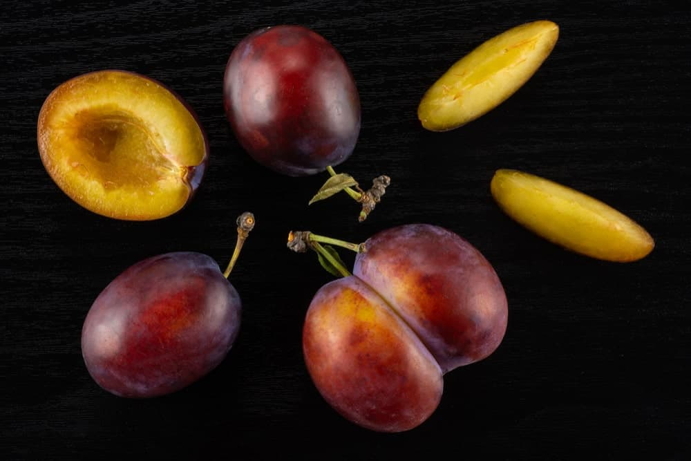 Fresh Moyer plums on a Black Table