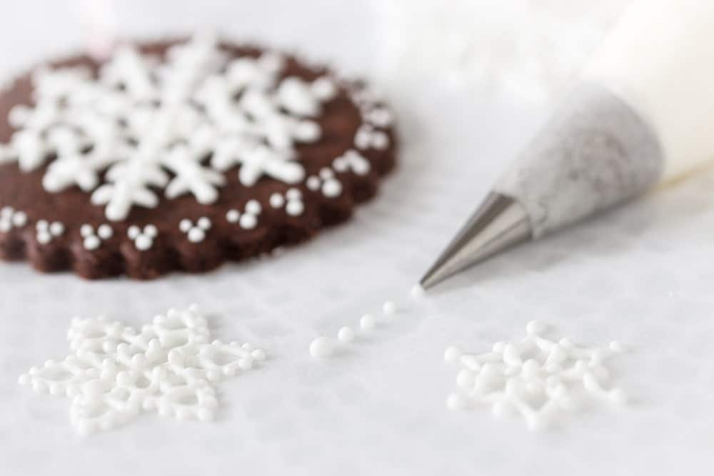 Cookie with White Royal Icing Snowflakes