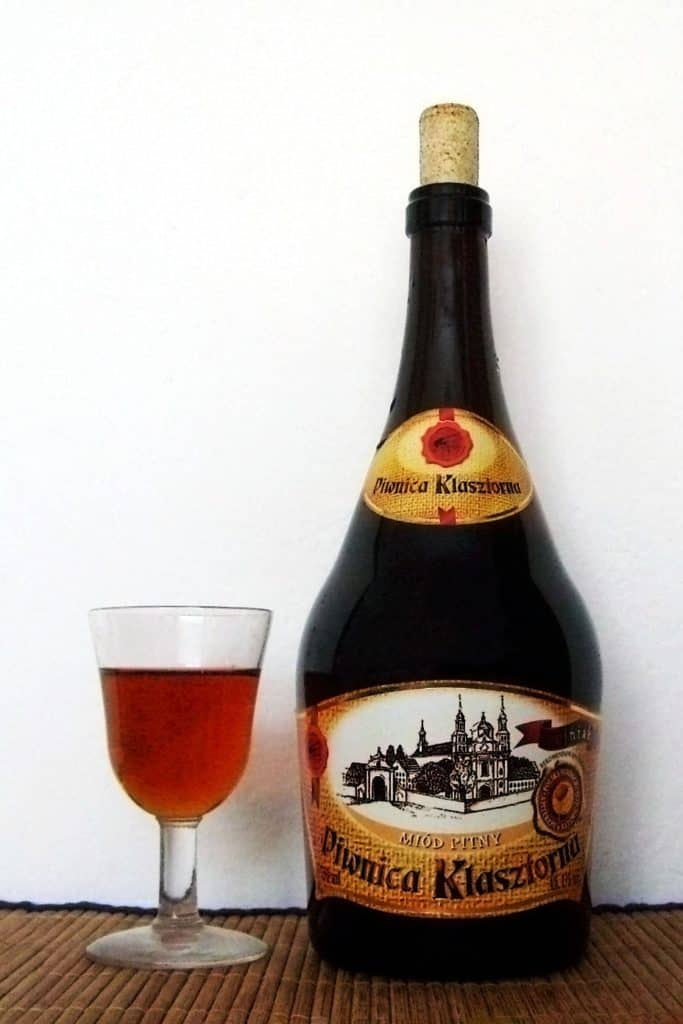 A bottle of medium-dark Trojniak mead made from one part honey and two parts water