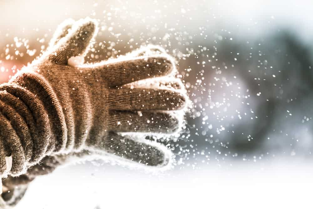 Wool gloves in snow