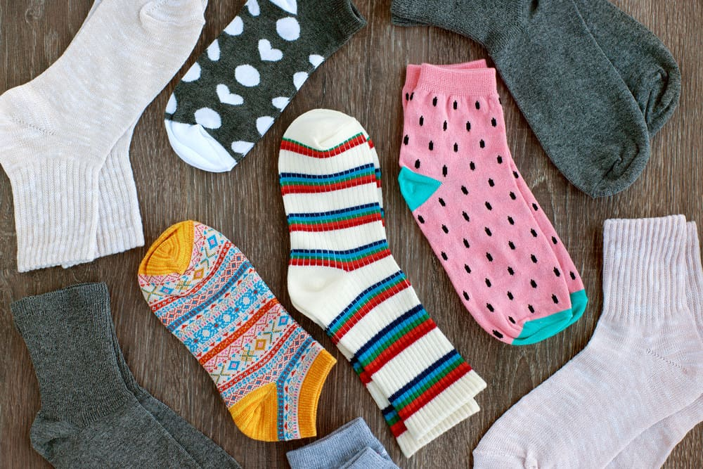 different socks on table
