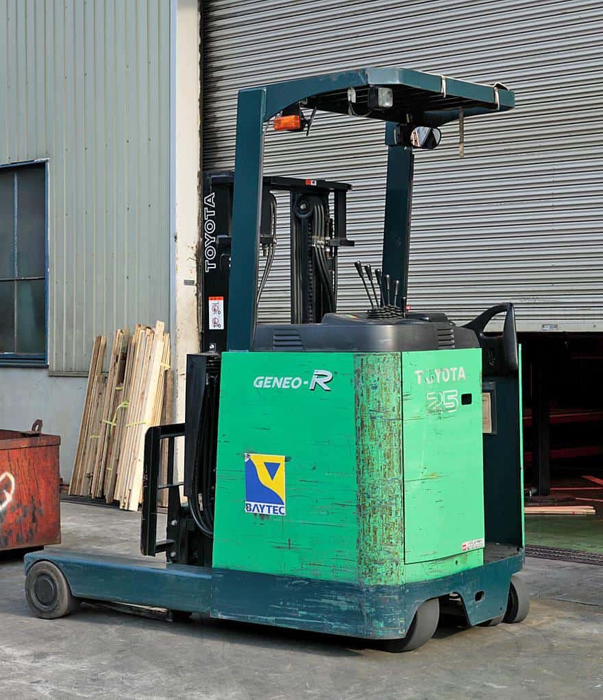 A green battery reach forklift
