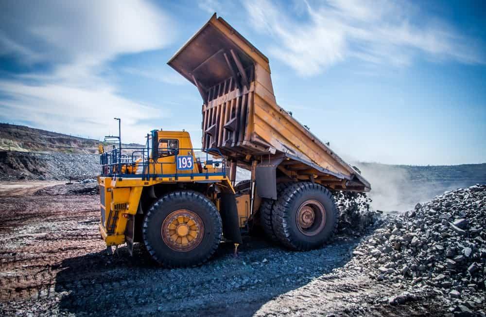 A dump truck dumping iron ore