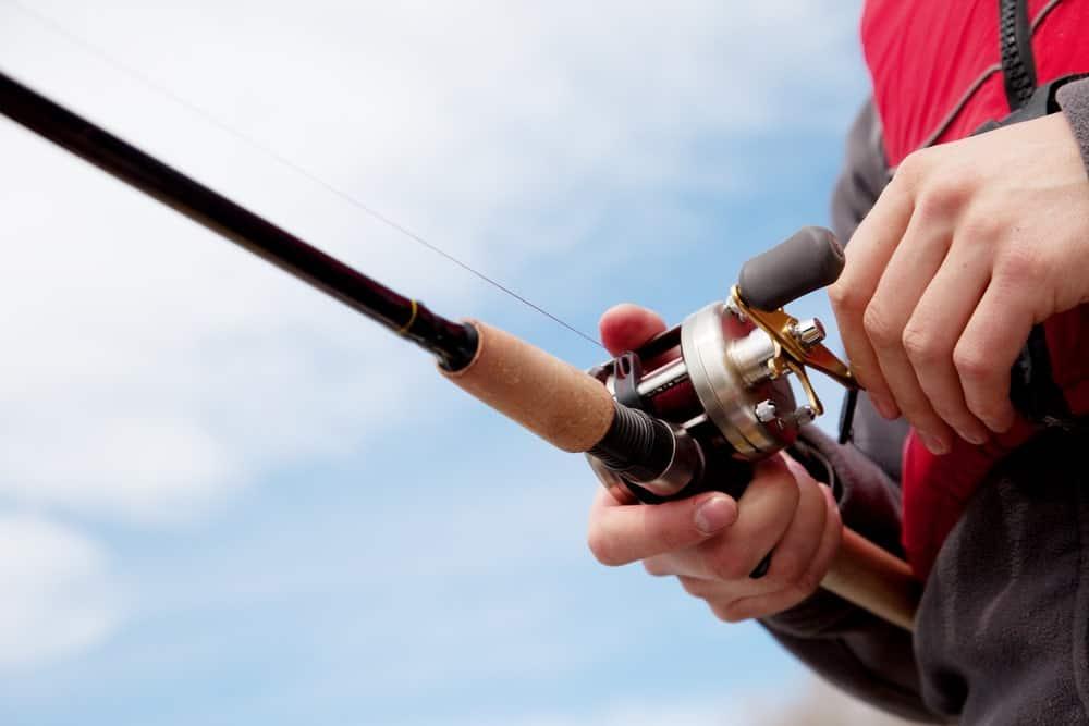 Man Using Fishing Reel