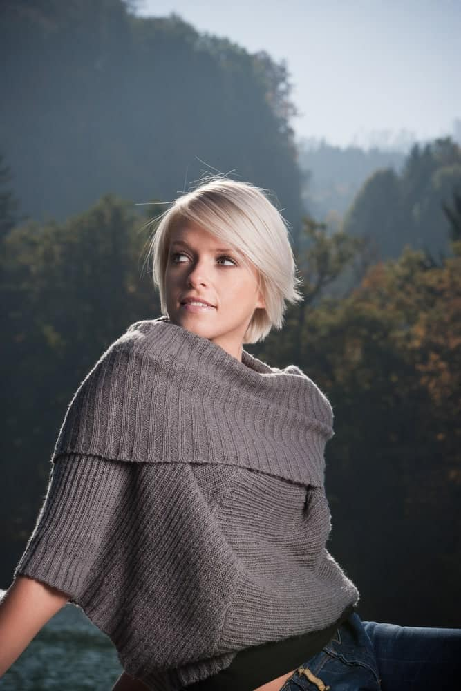 A Woman Wearing a Gray Cowl Neck Sweater
