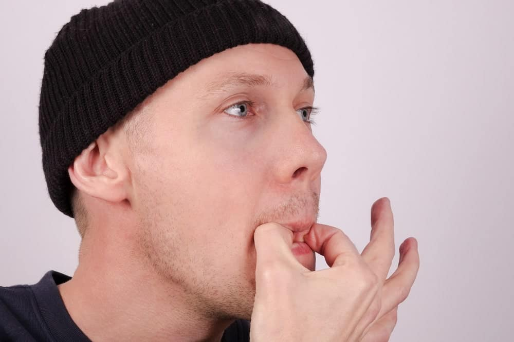 A Man Attempting to Whistle with His Fingers