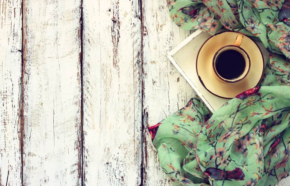 Chiffon scarf with a coffee mug on a wooden table