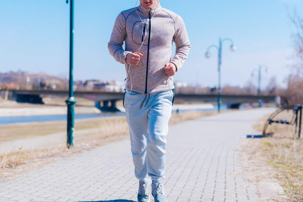 A man running in sweatpants.