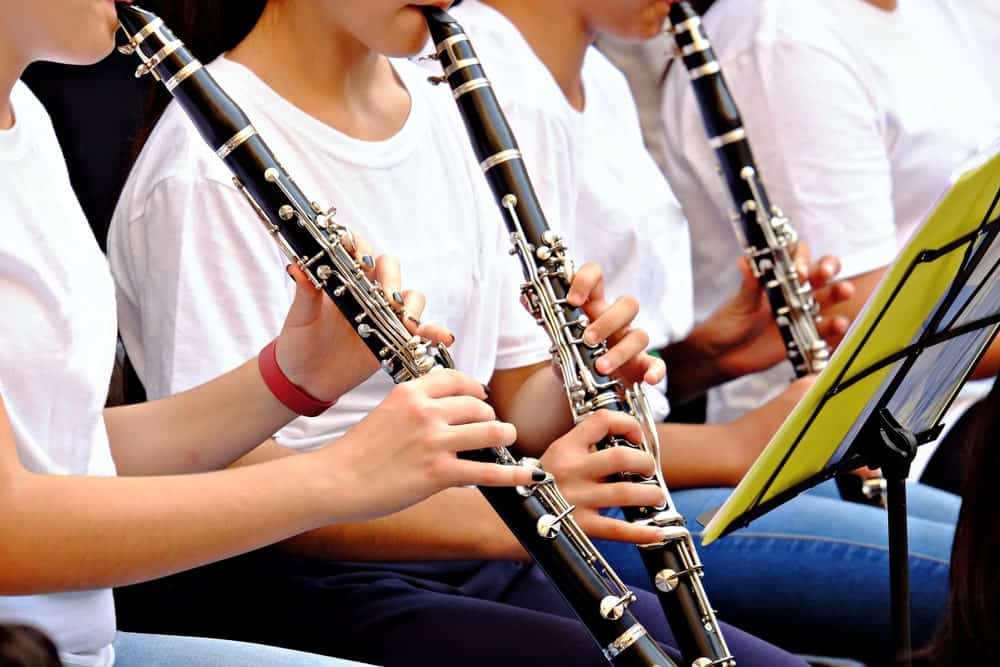 People playing the clarinet