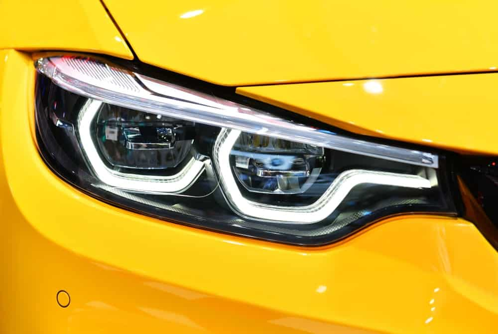 LED headlights of a yellow car