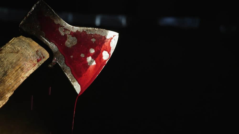 Bloody hatchet against a black background.