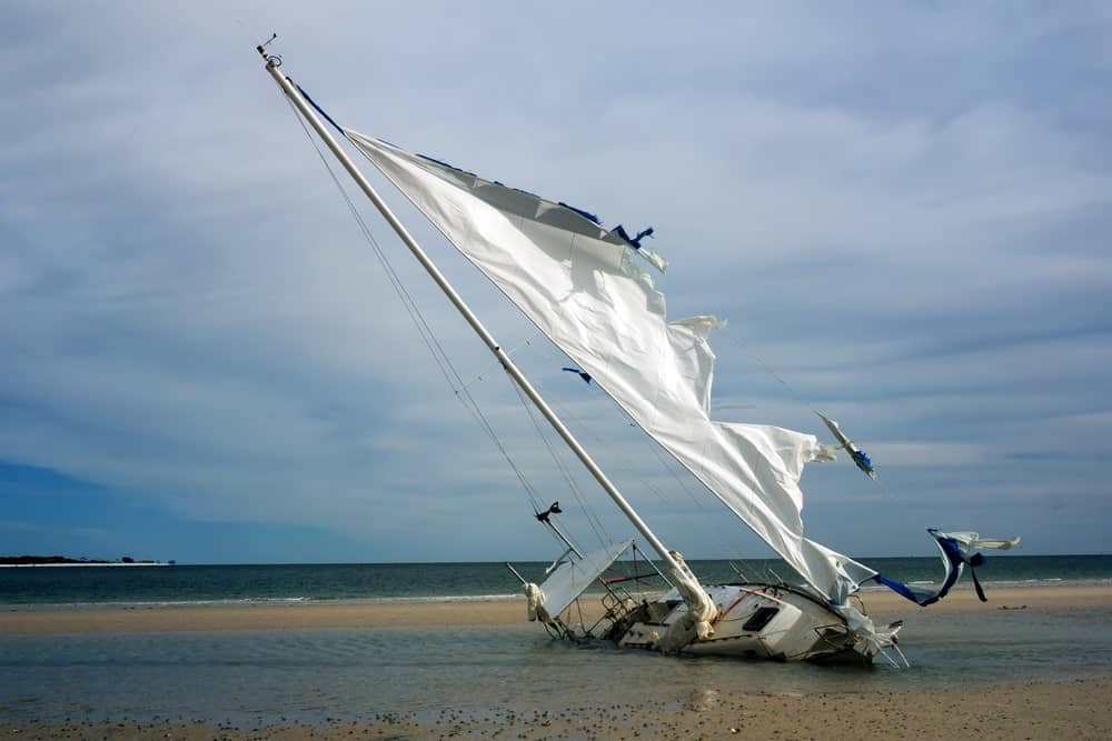 Destroyed yacht with torn mast.