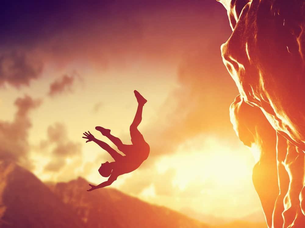 A man falls off a cliff.