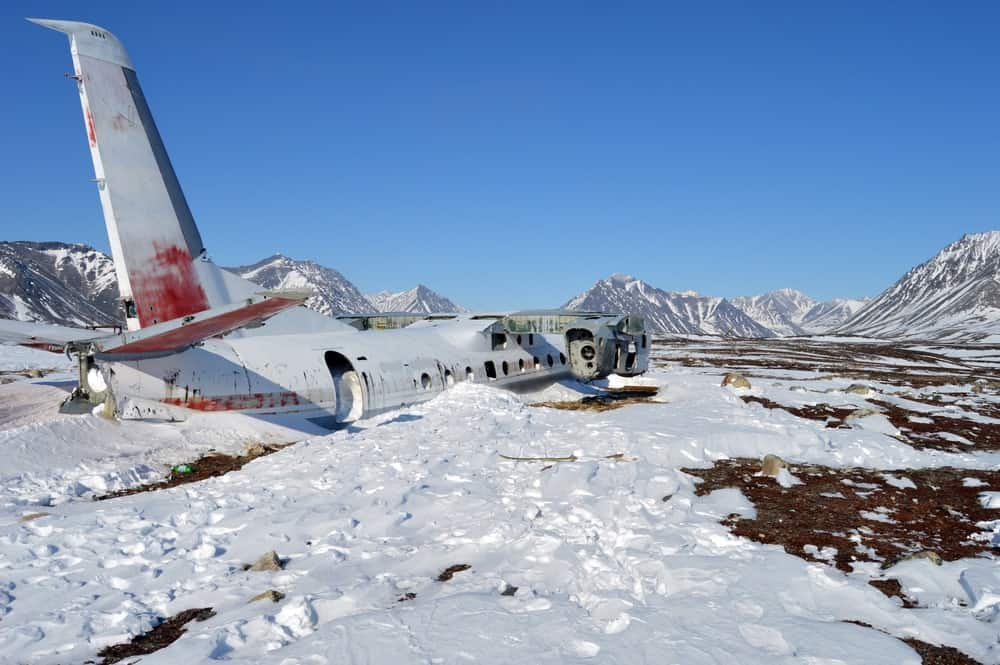 Plane wreck in a snow mountain.