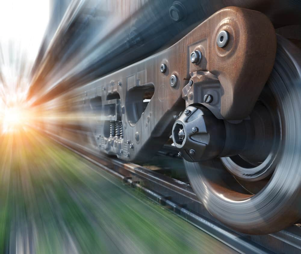 Closeup of train wheels in motion.