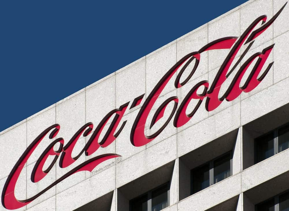 Coca-Cola logo on a building exterior.