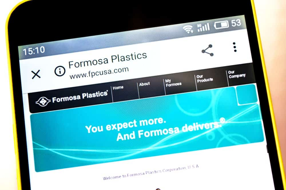 Formosa Plastics logo visible on the phone screen.