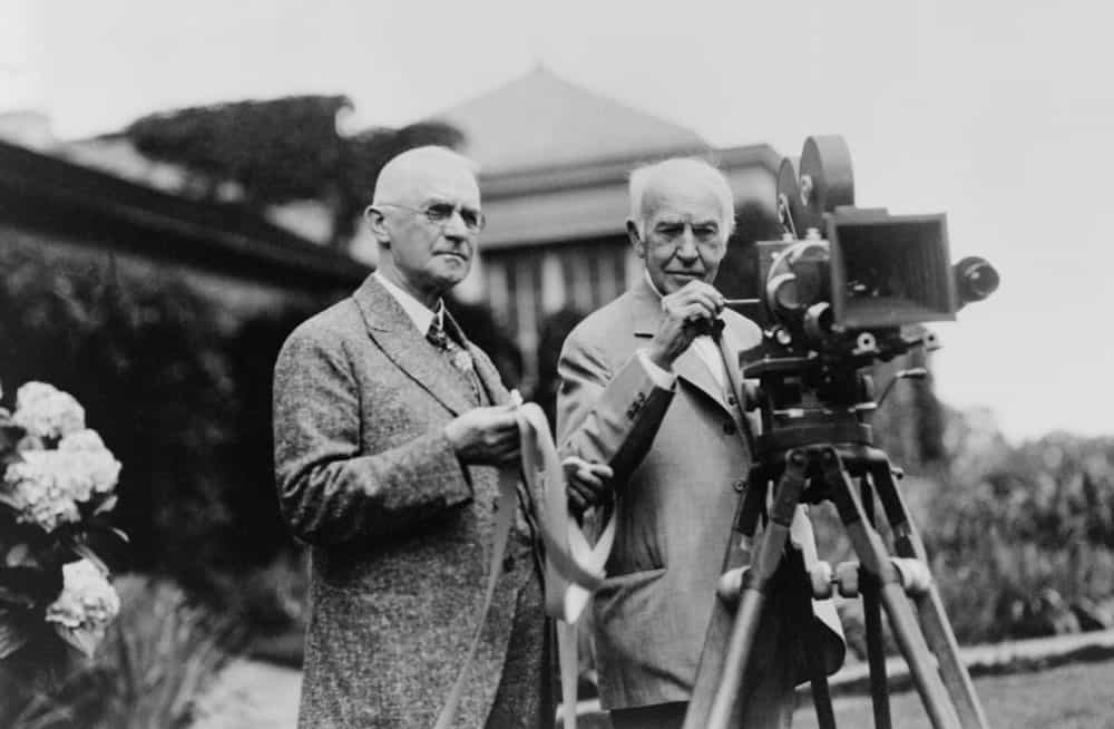 Thomas Edison and George Eastman standing with motion picture camera ca. 1925.