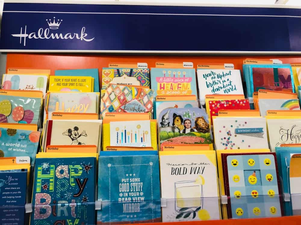 A Hallmark greeting cards (birthday cards) display inside of a store.