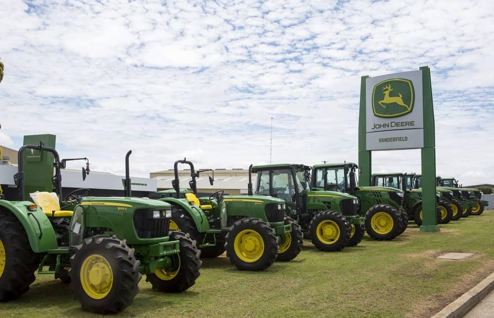 John Deere signage surrounded by John Deere tractors.