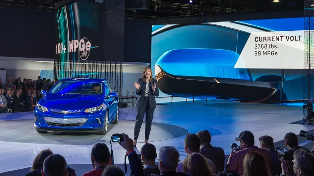 Mary Barra speaking to an audience at the 2016 Chevrolet Volt reveal at the North American International Auto Show (NAIAS).