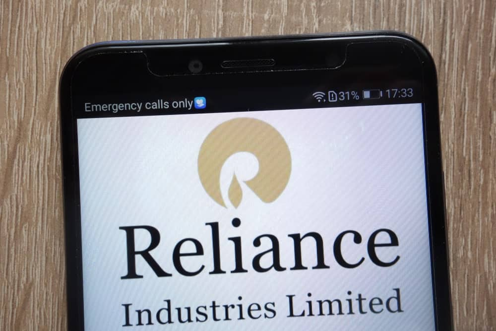 Reliance Industries logo displayed on a modern smartphone.